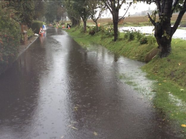 This image has an empty alt attribute; its file name is crabtree-lane-flooding-1140x855-1.jpg